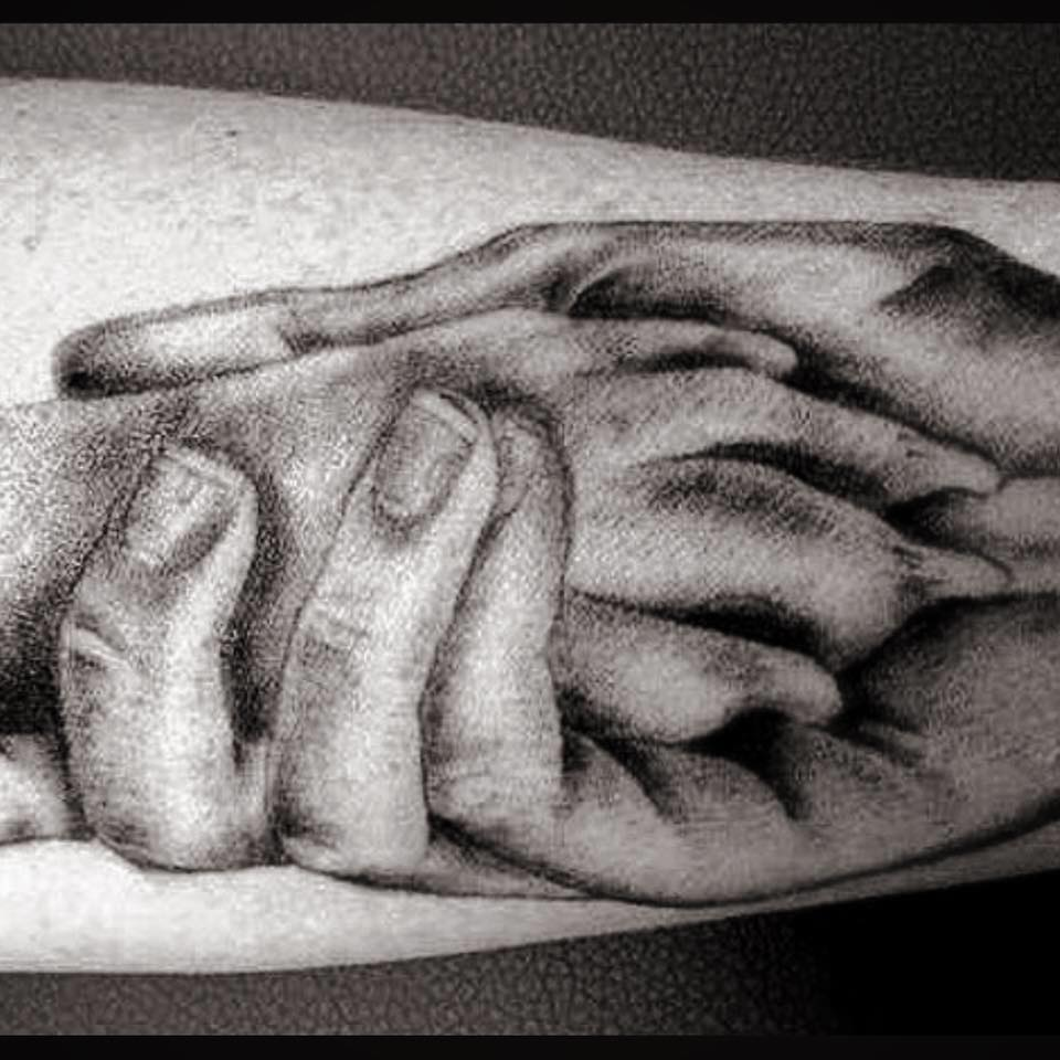 Hand drawn picture of a person holding a dog's paw